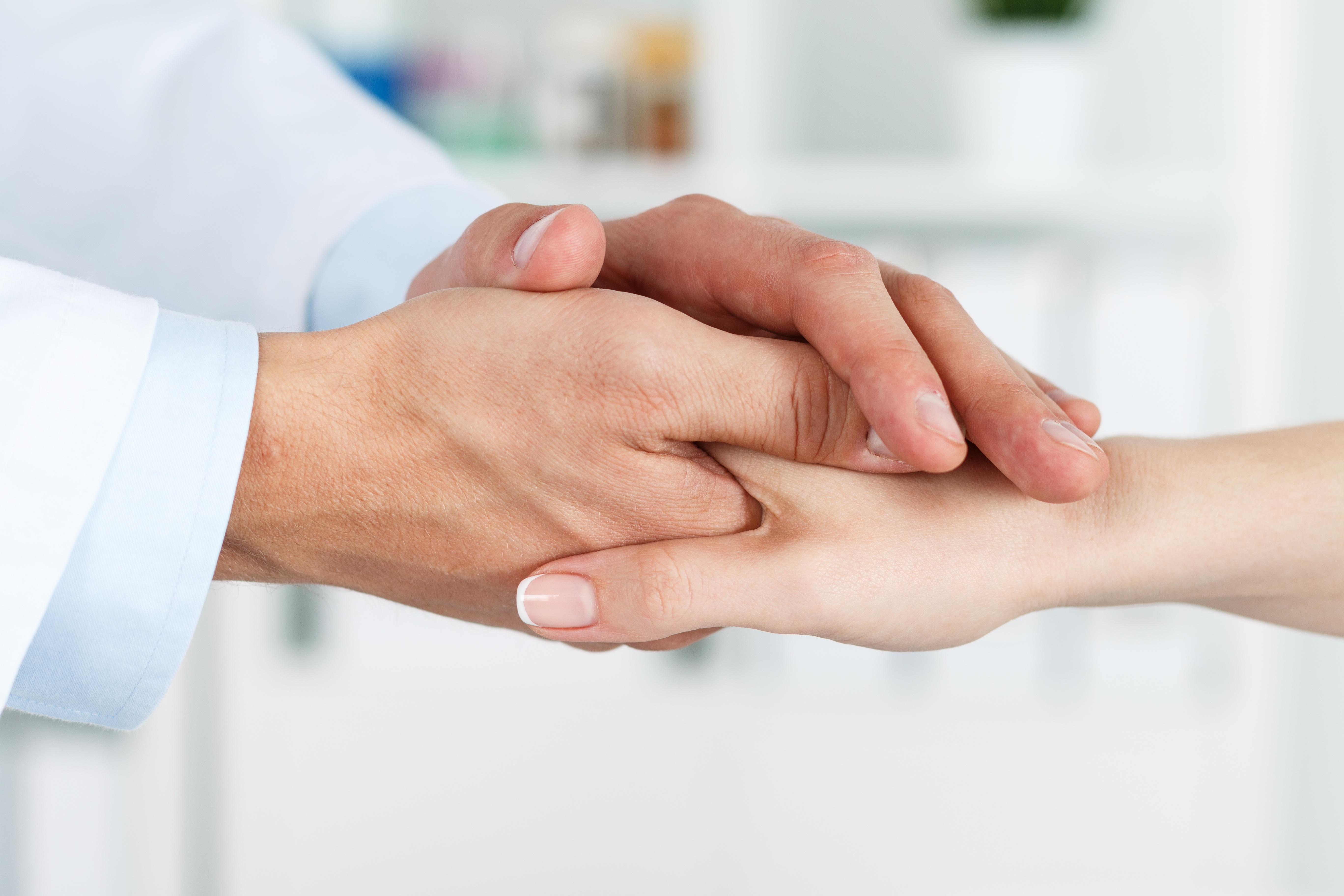 doctor_patient_holding_hands.jpg